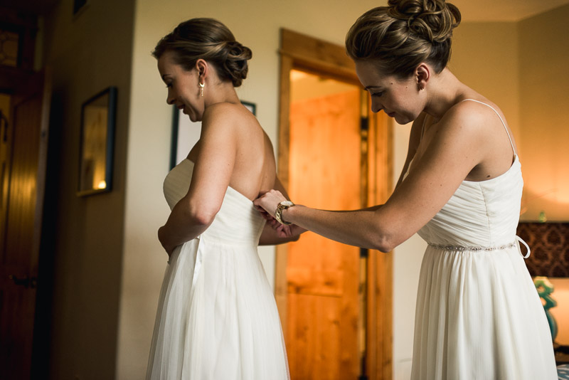 steamboat springs wedding photography putting on dress