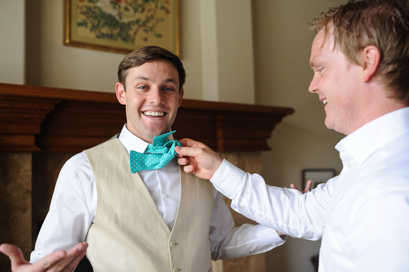 Denver Wedding Photography Cherokee Ranch and Castle groom bow tie funny