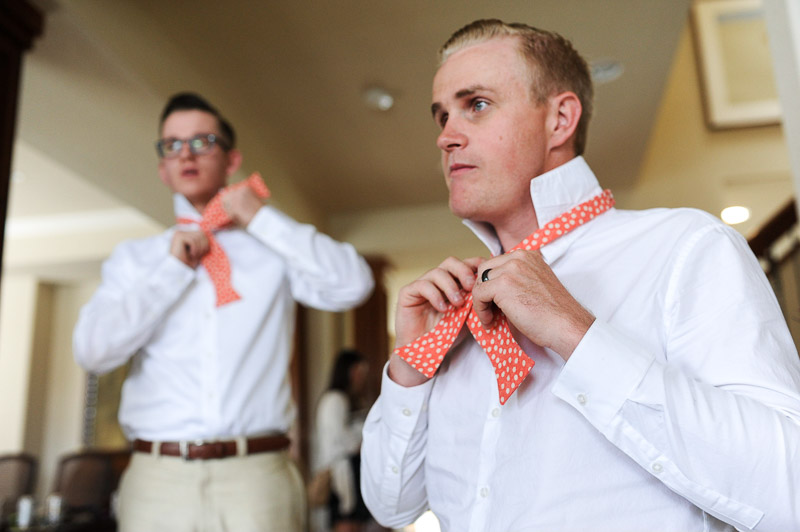 Denver Wedding Photography Cherokee Ranch and Castle tying bow tie
