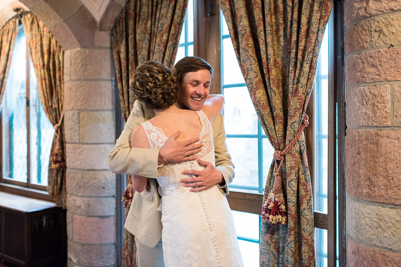 Denver Wedding Photography Cherokee Ranch and Castle first look hug