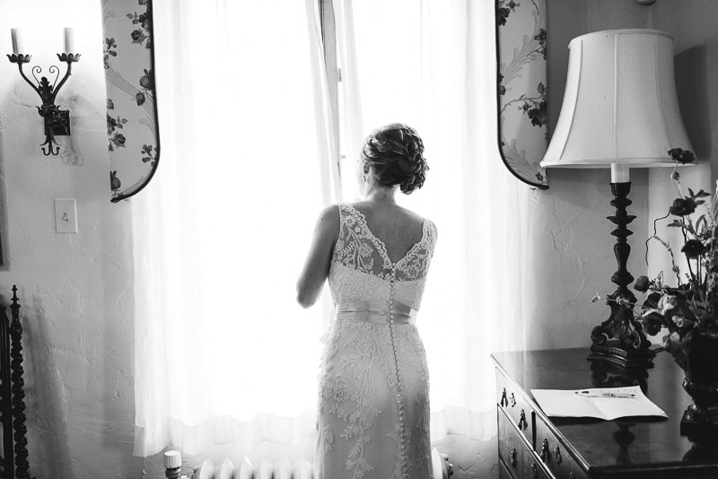 Denver Wedding Photography Cherokee Ranch and Castle bride looking out window