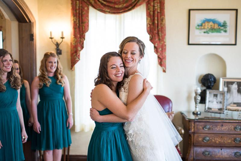 Denver Wedding Photography Cherokee Ranch and Castle bride hug