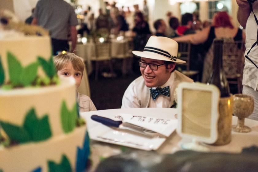 morrison willow ridge manor wedding photographer groom looking at cake