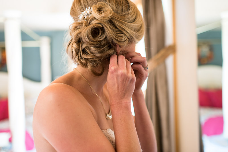 Emily and Ryan Lower Lake Ranch Wedding Photography bride earrings