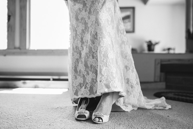 Emily and Ryan Lower Lake Ranch Wedding Photography putting shoes on