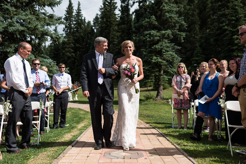 Emily and Ryan Lower Lake Ranch Wedding Photography bride walking down aisle