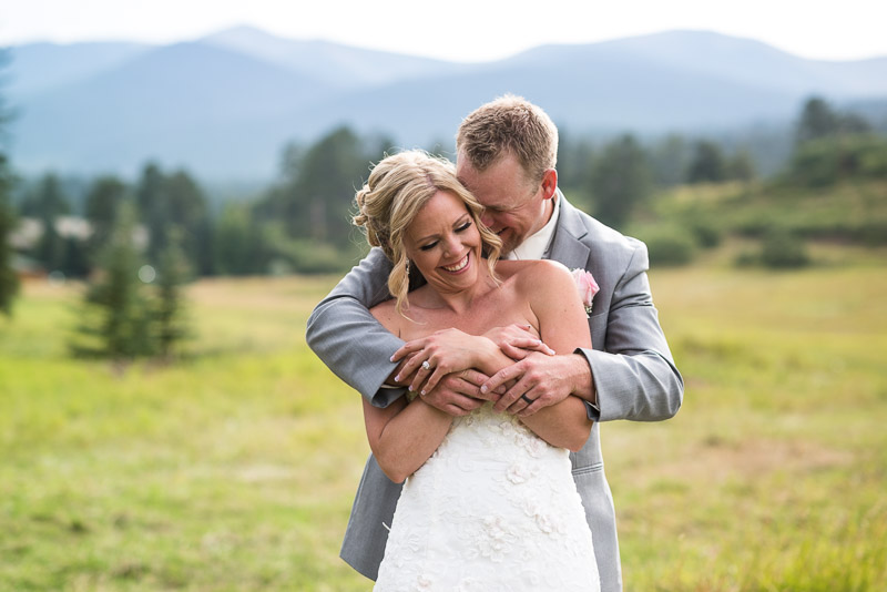 Cuchara Wedding Photographer laughing couple in mountain field