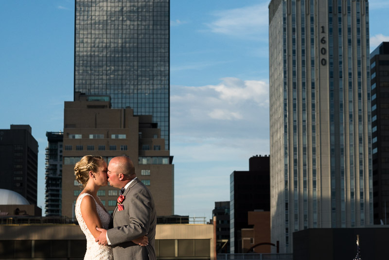 Denver athletic club wedding sunset kiss