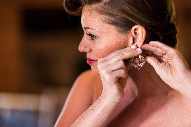 Lake Tahoe Wedding Photographer bride putting on earring