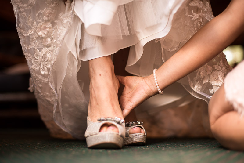 Lake Tahoe Wedding Photographer bride putting on shoes