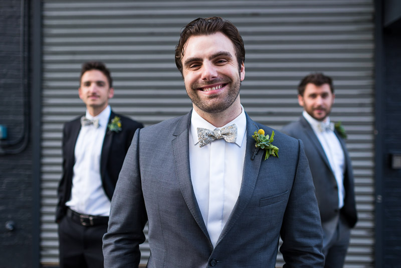 Groom and groomsmen smiling