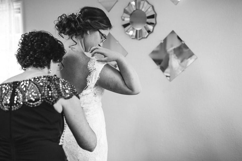 San Francisco Wedding Photography Villa Chanticleer bride putting on dress