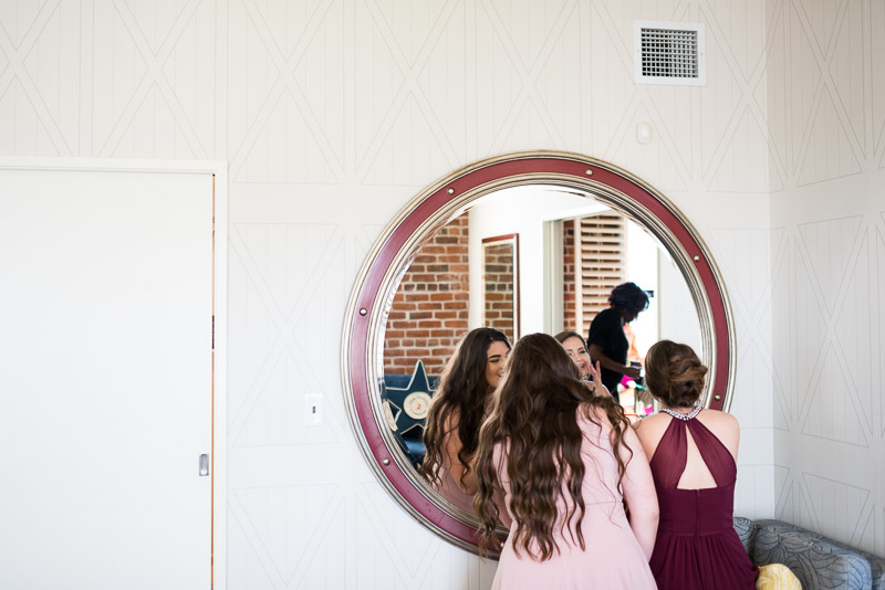 bridesmaids getting ready with mirror