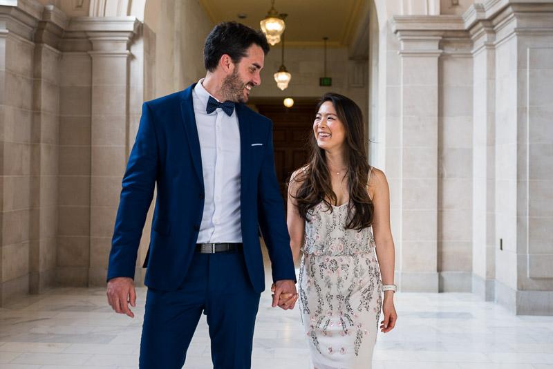 San Francisco City Hall Wedding Photography walking smiling