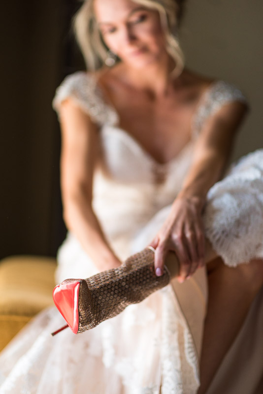 Vail Wedding Photography Camp Hale bride putting on shoes