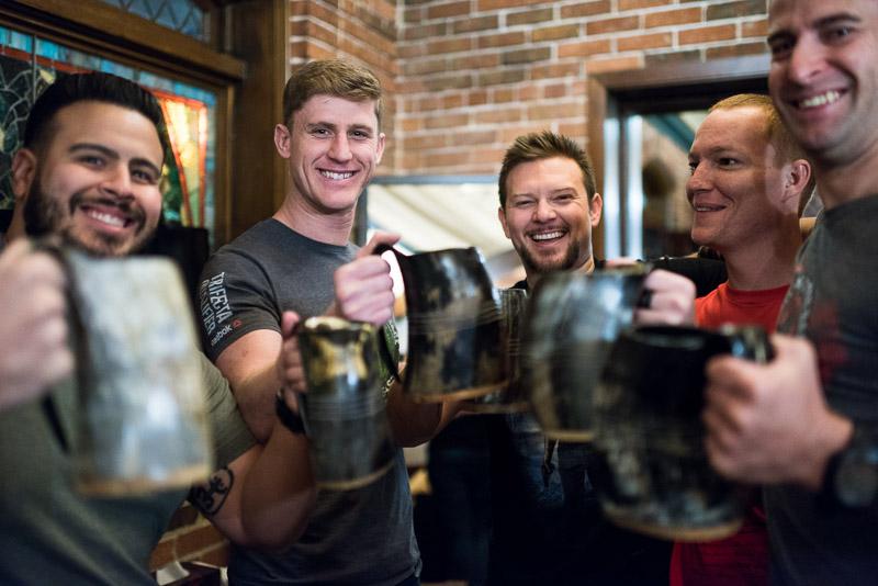 Denver Wedding Photography Wellshire Inn groom toasting horn mugs