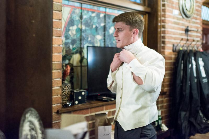 Denver Wedding Photography Wellshire Inn groom getting dressed