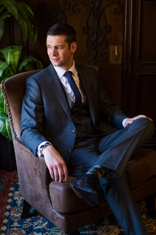 denver athletic club wedding photography groom in chair