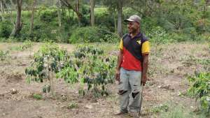 PNG Farm worker smiling - John Burton Ltd NZ
