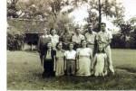 Claude Lee Cashon Family Photo  Front row Virginia (Jinna), Elizabeth (Bid), Ruth (Tootsie), Margaret Anne, Rose M (Babe) Back row Virginia Elizabeth (Vergie)-Wife of Claude, Annalee, John Jerome, George Lincoln, Herbert (Hub), Albert (Doon)