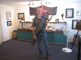Me holding a musket rifle in the Lloyd Tilghman House & Civil War Museum.
