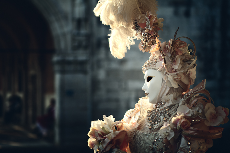 Photograph of a person in classic Venice Carnival mask and costume