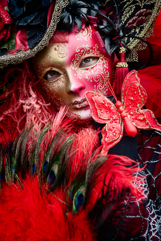 Photograph of woman in a red carnival costume in Venice Italy, 2012 during Carnival