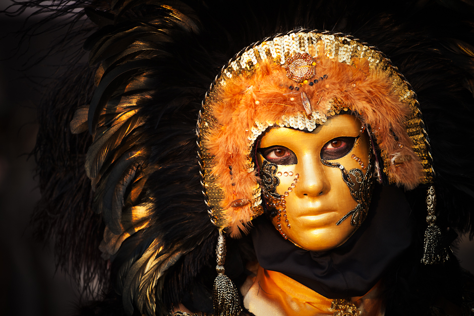 Photograph of a woman in yellow and gold carnival costume in Venice 2012