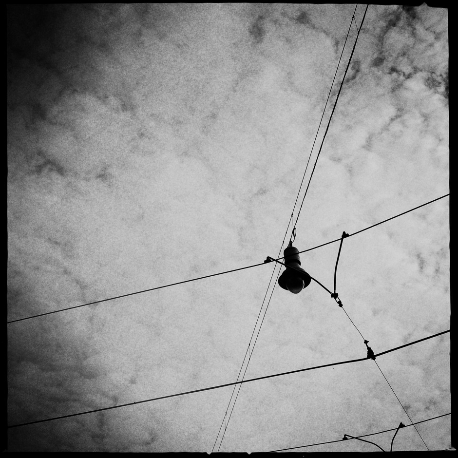 Black and white photograph of a overhead street light in Amsterdam taken with the iPhone and Hipstamatic
