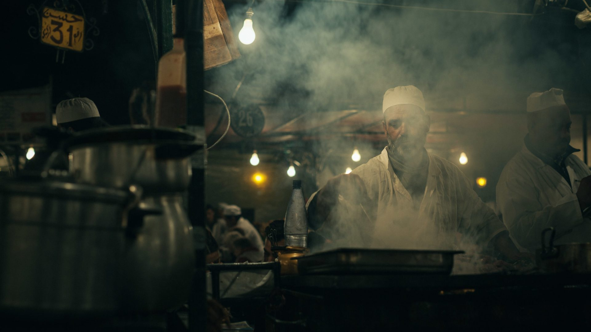 A man cooking at a stall at the Jemaa el-Fnaa Night Market in Marrakech
