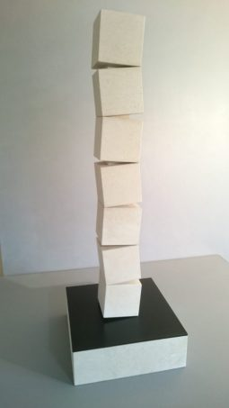 Abstract Stone Sculpture of Stacked Cubes.