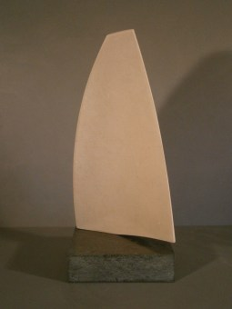 Stone sculpture of sail.