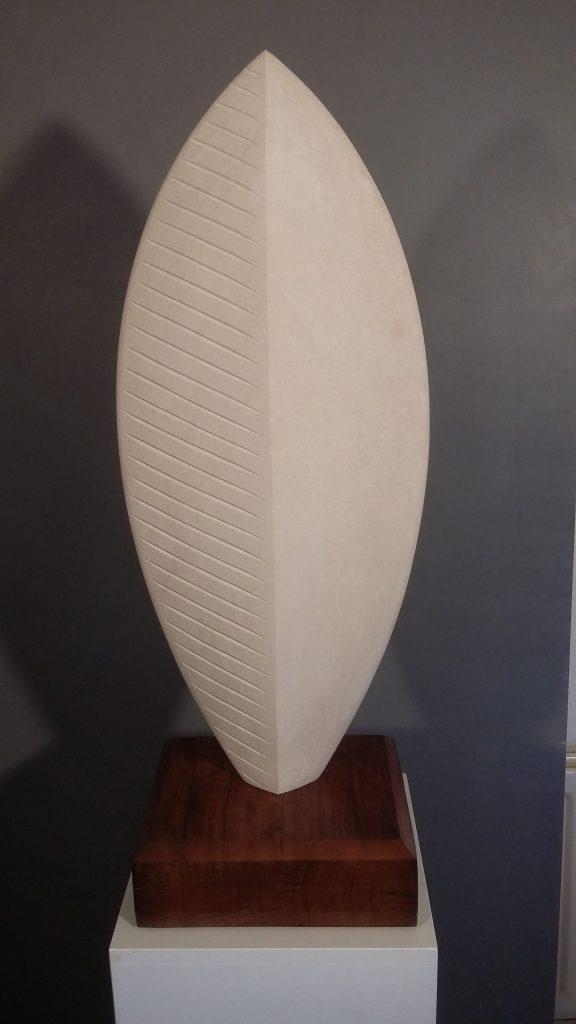 Stone shield sculpture in Portland Stone.