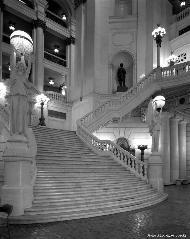 5-22-1984 Harrisburg Pennsylvania State Capitol buildiing-Cambo SC 4x5 view camera-90mm Schneider Super Angulon lens-Kodak Tri X Pan Pro 4x5 film-Kodak HC110B developer. Freedom is everything, but how free are we? Here is my story about this picture taken 32 years ago. I walked in the capitol building in Harrisburg Pennsylvania with a large metal camera case weighing 50 pounds, with a large tripod and a 4x5 view camera. I had no appointment, no request to photograph inside, no permit and no one knew who I was. I walked straight in, no guards, no security cameras, no security check stations, no x-rays, no probing, no questions, just people saying hi as I set up this shot which took more that 30 minutes to complete. Do you think I could do that now?