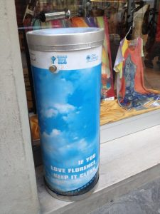 """Trash cans read, """"If you love Florence, keep it clean."""""""