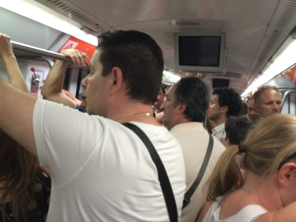 My subway car Wednesday. Rome gets about 10 million tourists a year, a good many of them coming in July.