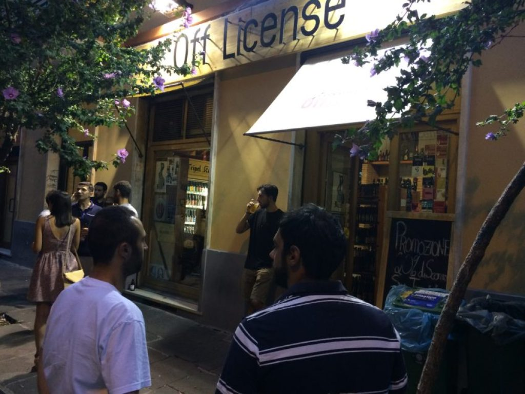 The crowd drinking outside Johnny's Off License, one of Rome's growing number of bottle shops.