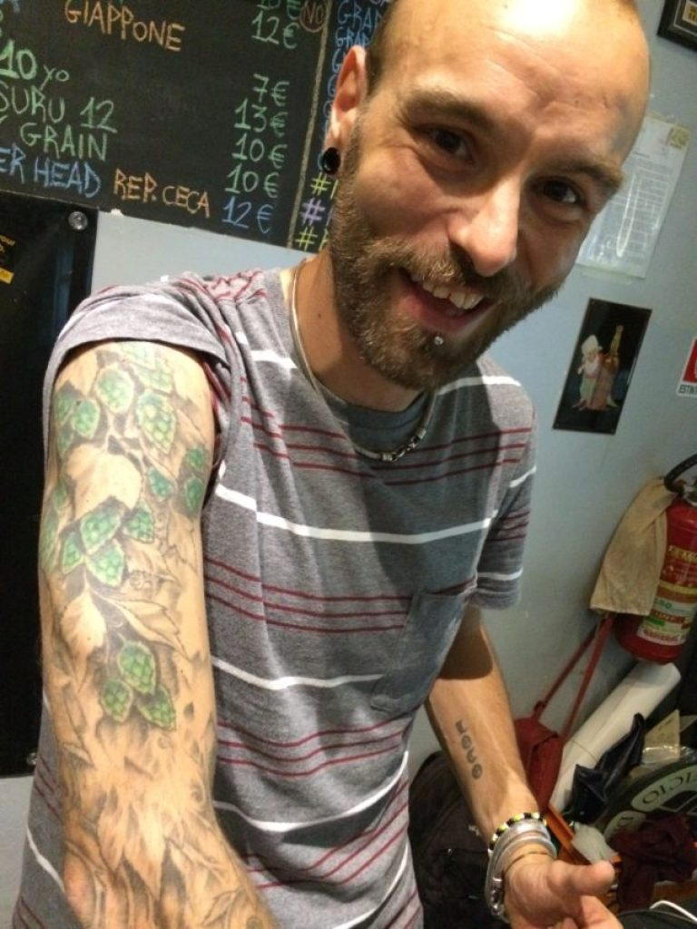 Bartender Massimiliano Vichi displays the hops tattoed on his arm at Birra Piu.