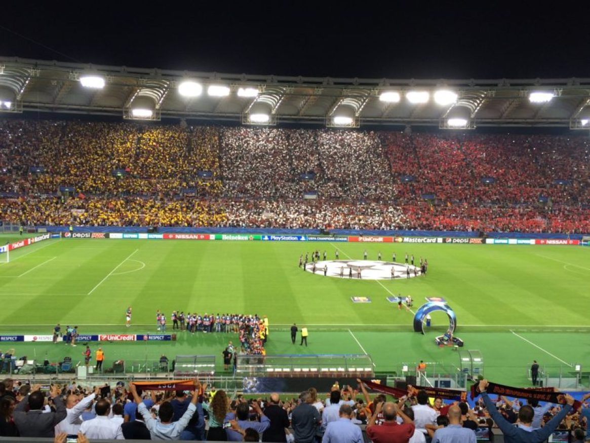 A packed Olympic Stadium crowd of 57,836, decorating the stadium in A.S. Roma colors, watched their team tie defending champions Barcelona as the Champions League kicked off for Roma Wednesday night.