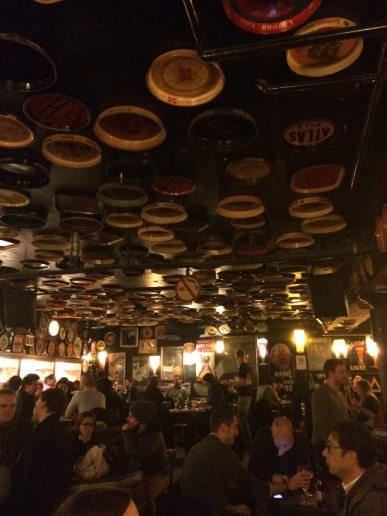 The ceiling of Delirium is covered in beer trays.