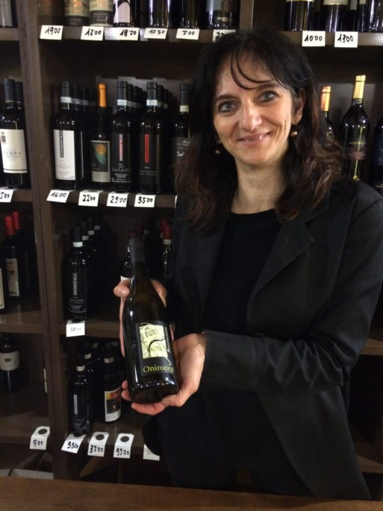 Simona of Enoteca Kursaal with our prized Pecorino wine.