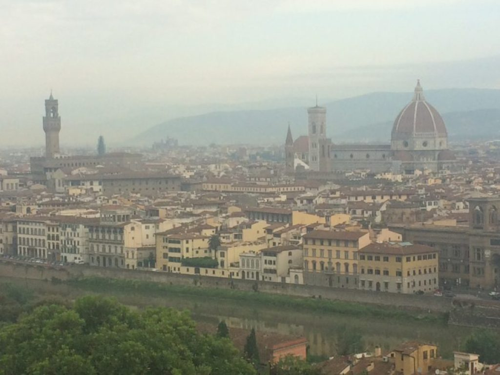 Florence in the morning mist with the Duomo on the right and the tower in the Palazzo di Vecchio on the left.