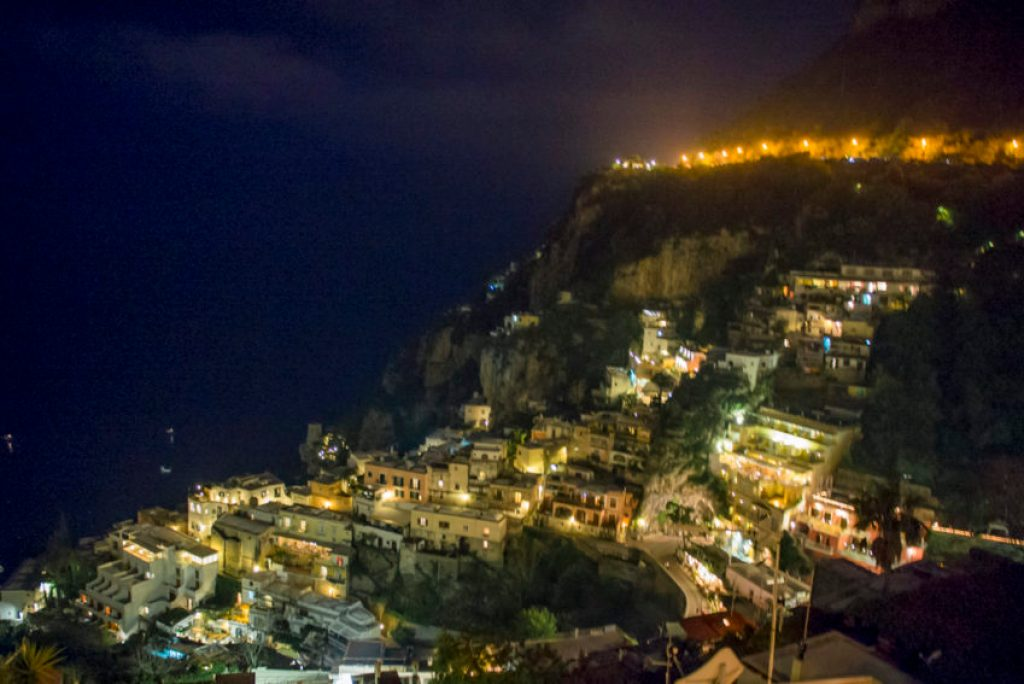Few places in Italy are more romantic than Positano at night. Photo by Marina Pascucci