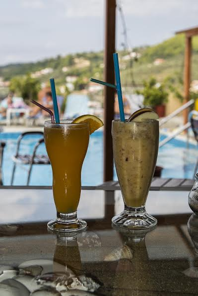 Our first pool-side drinks at the Poseidon Villas. Photo by Marina Pascucci
