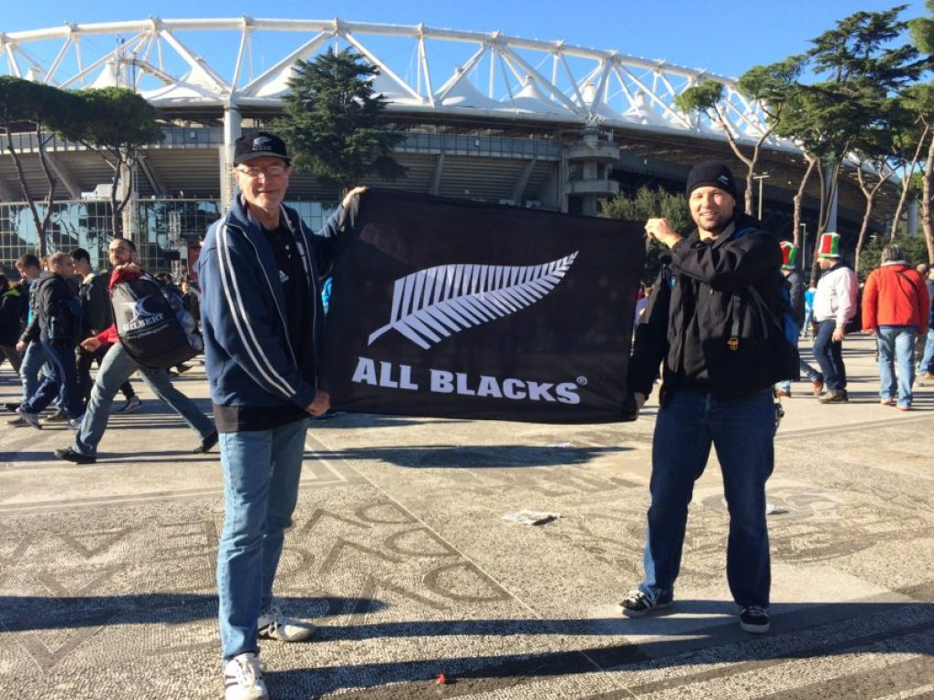Mike Dixon from New Zealand, left, and Mike Gerull from Germany hold up the All Blacks banner Gerull brought down from Zurich for the game.