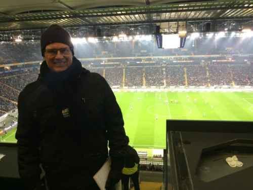 Grinning and bearing it while attending a game with the flu in 38-degree Frankfurt.