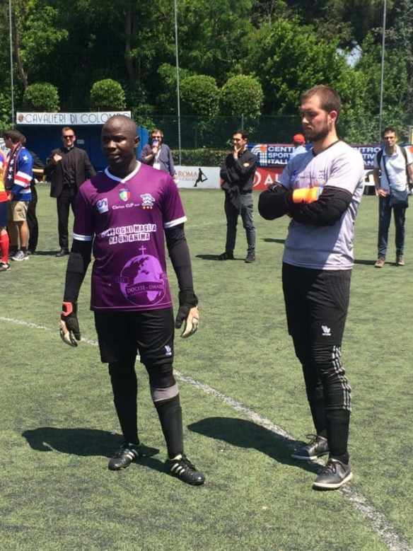 Goalkeepers Emmanuel Umanah of Collegio Urbano and Nigeria and Stephen Cieslak of the North American Martyrs and Portland, Oregon, before the shootout.