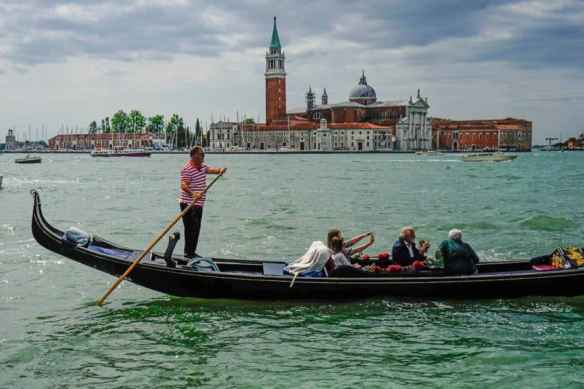 A gondolier with Giudecca, the southern most neighborhood in the background. Photo by Marina Pascucci