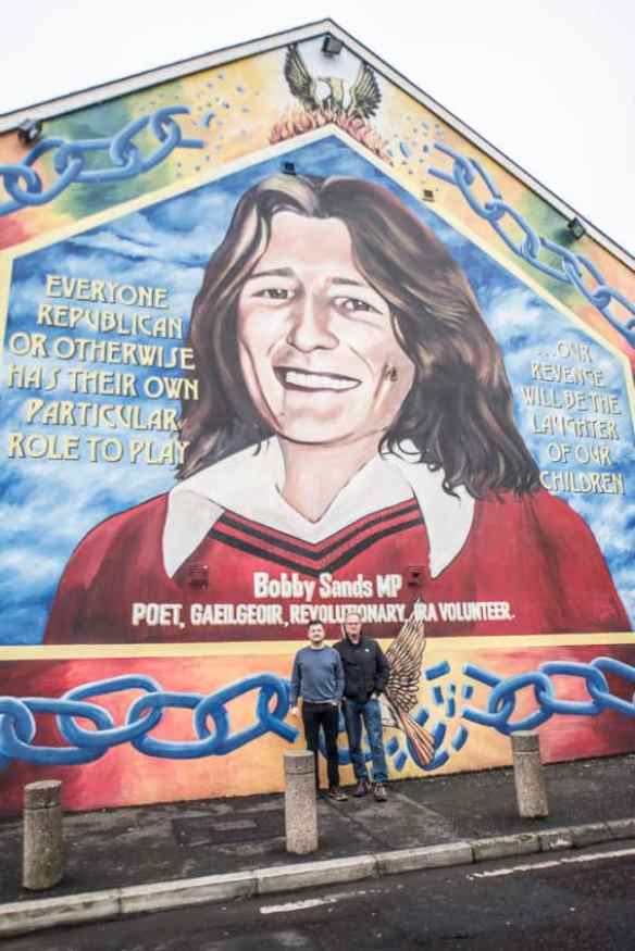 Patrick O'Byrne and I in front of the Bobby Sands mural on Belfast's Falls Road. Photo by Marina Pascucci