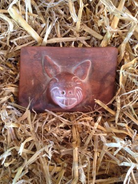 And why does that strange old tile have a wolf's head on the back? Or is it a wild boar?